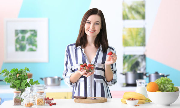 bigstock-Young-woman-holding-strawberry-216985573